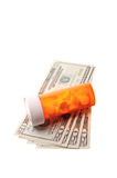 Pills and cash Royalty Free Stock Photos