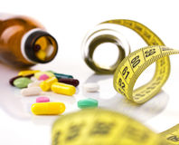 Pills  and centimeter Royalty Free Stock Photo