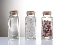 Pills in Clear Bottles Stock Image
