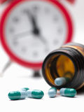 Pills and clock Stock Photo