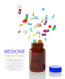 Pills come out from a bottle Royalty Free Stock Photography