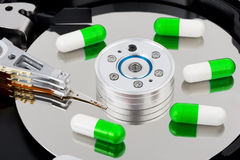 Pills on computer hard drive Stock Images