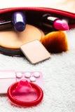 Pills, condom and cosmetics in handbag. Stock Photos