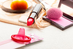 Pills, condom and cosmetics. Stock Images