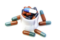 Pills in container Stock Photos