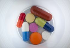 Pills on cup 2 Stock Photo