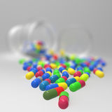 Pills 3d spilling out of pill bottle on Stock Photo