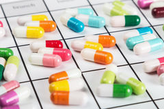 Pills are of different color on the calendar Royalty Free Stock Photography