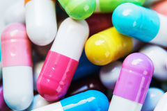 Pills of different colors background Stock Photography