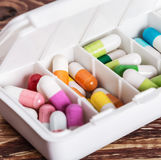 Pills of different colors in a box Stock Photo