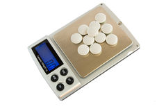 Pills on digital scales Royalty Free Stock Photography