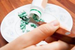 Pills dish Stock Photography