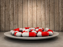 Pills on dish Stock Images
