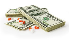 Pills dollars Stock Images