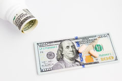 Pills and dollars. A few pills and a dollar bill Royalty Free Stock Photo