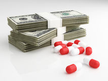 Pills and dollars Royalty Free Stock Photography