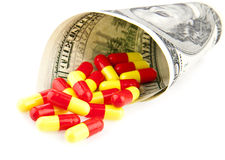Pills and dollars. On a white background Stock Photos