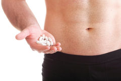Pills drag tablet boxes supplements Man isolated. Vitamin or pill drag tablet Man isolated offering pill in one and pills in bottle - in another hand. Copy space stock photography
