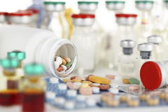 Pills/drug. Photographed color pills and vaccines batches Stock Photography
