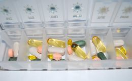 Pills drugs colored macro in container stock photos