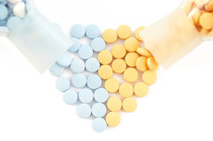 Pills and drugs forming heart on white Royalty Free Stock Image