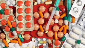 Pills and drugs on a table stock footage