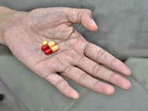 Pills on elder hand Stock Photo