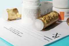 Pills on empty medical prescription Royalty Free Stock Photography