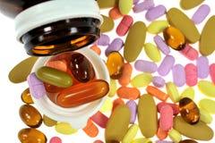 Pills en pillflaska Arkivbilder