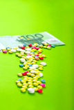 Pills with euro. Pills and tablets with Euro bill Stock Image