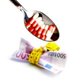 Pills on euro Royalty Free Stock Images