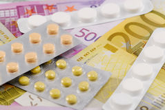 Pills on European banknotes Royalty Free Stock Photos