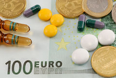 Pills on European currency Royalty Free Stock Photos
