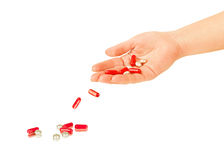 Pills falling out of hand Stock Image