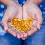 Pills of fish oil Stock Photos