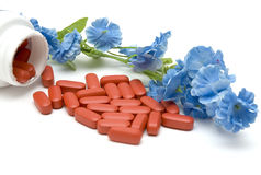 Pills and flower Royalty Free Stock Photo