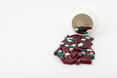 Pills in folded paper. On white background in studio Stock Images