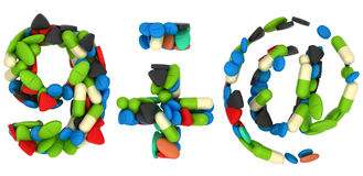 Pills font 9 plus minus and at symbols Royalty Free Stock Image