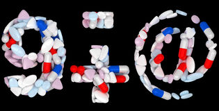 Pills font 9 plus minus and at symbols Stock Photo