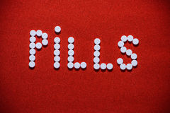 Pills formed in the word `PILLS` Stock Images