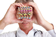 Pills in front of a face royalty free stock photography