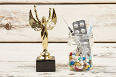 Pills in glass and award. Stock Photo