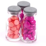 Pills in Glass Bottles on White Background Stock Photos