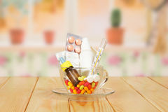 Pills in glass cup Stock Photo