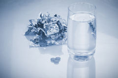 Pills and glass of drink water Royalty Free Stock Images