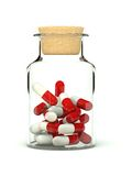 Pills in glass medicine bottle Royalty Free Stock Photo