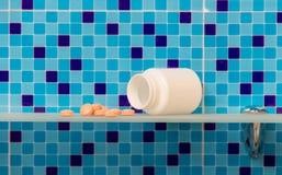Pills on glass shelf Stock Images
