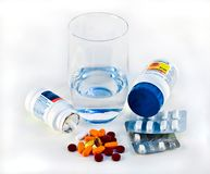 Pills and Glass of Water Royalty Free Stock Image