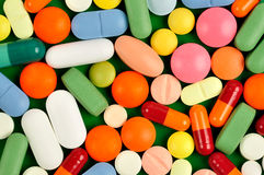 Pills on Green Royalty Free Stock Images