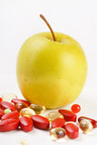 Pills and green apple Royalty Free Stock Photography